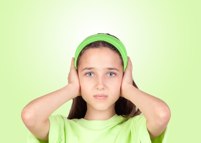 Child Covers Ears to Noise