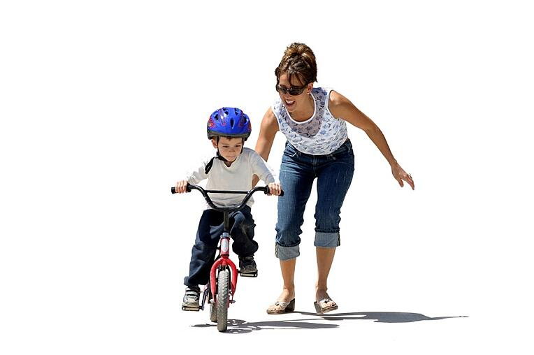 Child Learning to Ride Bike   Development Milestone